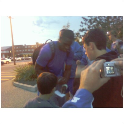 Patrick Patterson takes care of a young fan
