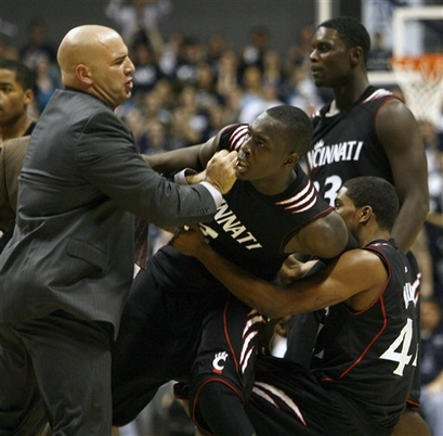 Andrews restrains some impassioned Bearcats.  (credit: AP)