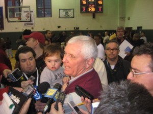 Bob Hurley takes a rare moment, grandson in tow, to speak with reporters following his 1000th victory.