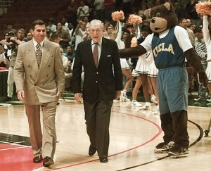 Jim Harrick (left) accompanies legend John Wooden at a UCLA ceremony.