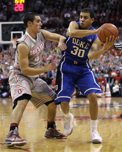 Aaron Craft (left) made sure the Buckeyes sealed a win over the top-ranked Spartans on Sunday.