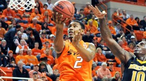 After Spinning His Wheels For Most Of The Season, LeBryan Nash Raised The Roof In Stillwater. (AP)