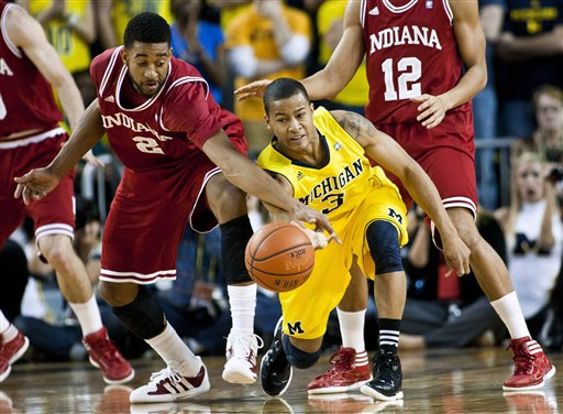 Can Trey Burke take his game to another level in March? (AP Photo/T. Ding)