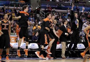 March Madness in full swing as (from left to right) as Challe Barton, Rhys Murphy, Kevin McShane, and Angus Brandt celebrate Oregon State's 86-84 win over Washington. (credit: Jae Hong)