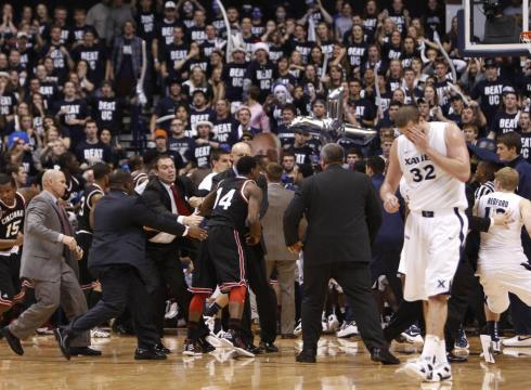 Last year's Cincinnati-Xavier brawl was ugly, so now everyone loses next season (AP Photo)