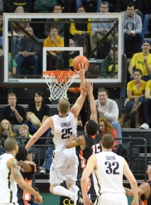 E.J. Singler leaps in for a put-back off of Damyean Dotson's missed three-pointer. (Photo by Rockne Andrew Roll)
