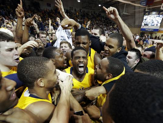 Ramon Galloway and His Teammates Exult in a Court Storm After Knocking Off Butler (Matt Slocum, AP)