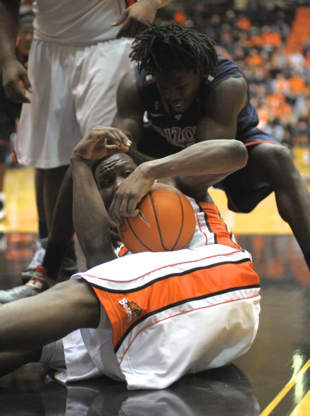 Jarmal Reid asks for a time out to save a recovered loose ball.  (Photo by Rockne Andrew Roll)