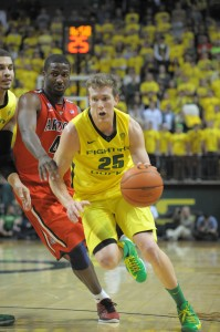 "EJ Singler drives the lane against the Arizona Wildcats at Matthew Knight Arena. Singler described beating the 'Cats at the ""Biggest win of my career."" (Photo by Rockne Andrew Roll)"