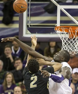 Aziz N'Diaye Contests A Shot From Colorado's Xavier Johnson (Dean Rutz, Seattle Times)