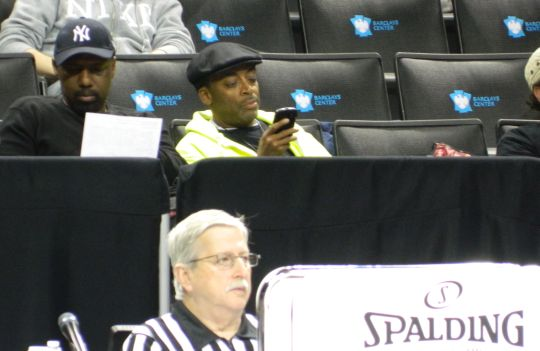 Spike Lee (with phone) made his way south from Madison Square Garden to catch some A-10 action Friday evening. (Staff photo)