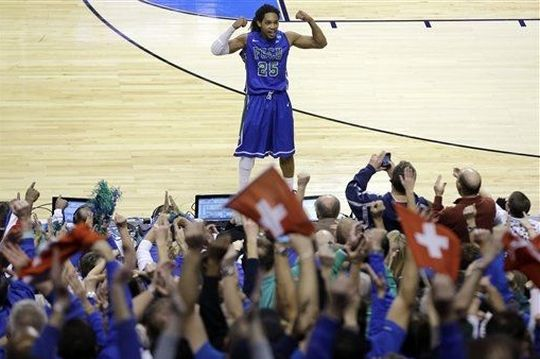 Sherwood Brown celebrates with fans during the final minute of a second-round game against Georgetown. (AP)
