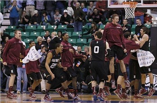 Harvard players run off the bench and celebrate after beating New Mexico during a second round game in the NCAA college basketball tournament in Salt Lake City Thursday. (AP)