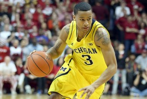 The national player of the year frontrunner, Burke has the means and the will to lead the Wolverines to a national championship (Getty Images).