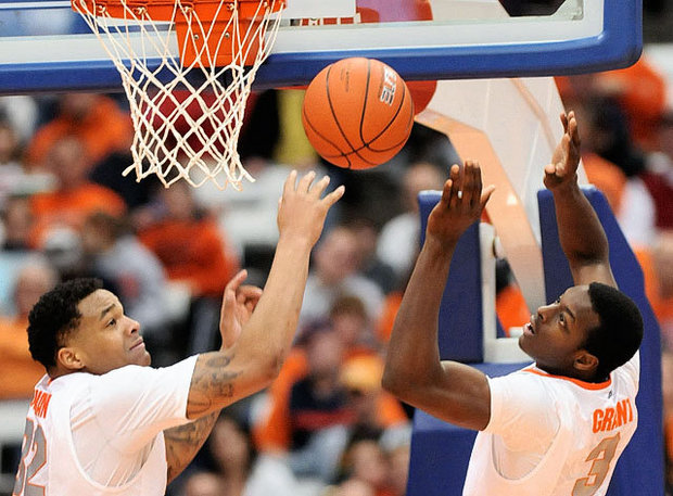 DaJuan Coleman and Jerami Grant seem perplexed (credit: Photo by Dennis Nett / The Post-Standard, syracuse.com)