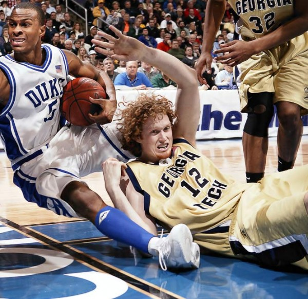 Luke Schenscher takes a tumble, bringing Duke's Daniel Ewing down with him (credit: Grantland.com/SI vault)