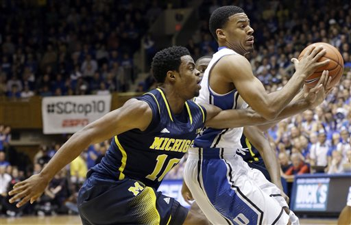 Derrick Walton Jr. had a huge basket to take the lead against Penn State last night and keep Michigan moving toward a NCAA berth (credit: ap.org)