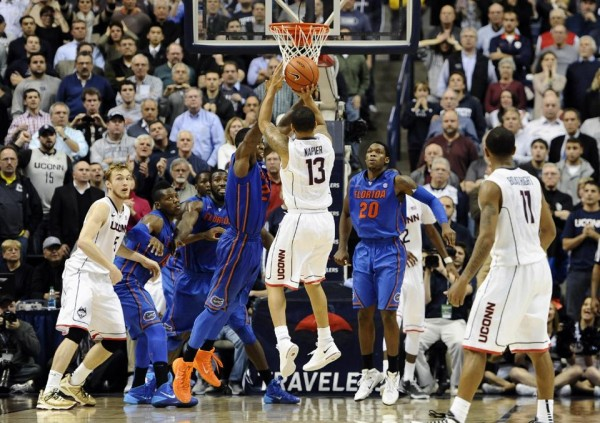 Shabazz Napier rises to take the game-winning jumper in UConn's 65-64 victory over Florida on Monday. (credit: AP)