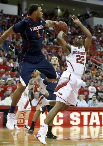 Virginia's Justin Anderson Blocks Ralston Turner of N.C. State In Cavalier Rout. (Photo: Ethan Hyman/AP)