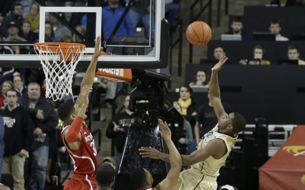 Wake's Codi Miller-McIntyre floats up a shot versus N.C. State (AP Photo/Chuck Burton)