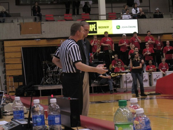 Southern Utah coach Nick Robinson discusses a foul call with a referee during the first half of his team's game against Eastern Washington in Cheney, Wash. (Kenny Ocker/Rush The Court)
