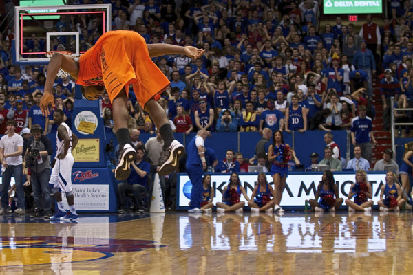 Marcus Smart pulled off a backflip in Allen Fieldhouse a season ago while Jayhawk fans and Elijah Johnson look on in disbelief. (Emily Wittler/KANSAN)