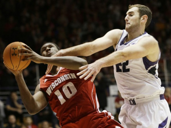 Alex Olah has turned into a defensive force for the improving Wildcats( Nam Y. Huh, AP).