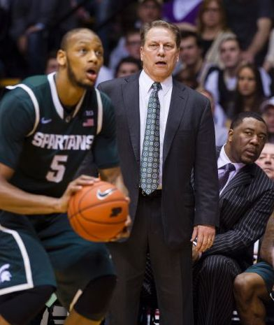 Michigan State head coach Tom Izzo watches from the sideline as Michigan States Adreian Payne (5) puts up a three-point shot in the second half of an NCAA college basketball game, Thursday, Feb. 20, 2014, in West Lafayette, Ind. Michigan State defeated Purdue 94-79. Payne scored a game-high 23 points in the game. (AP)
