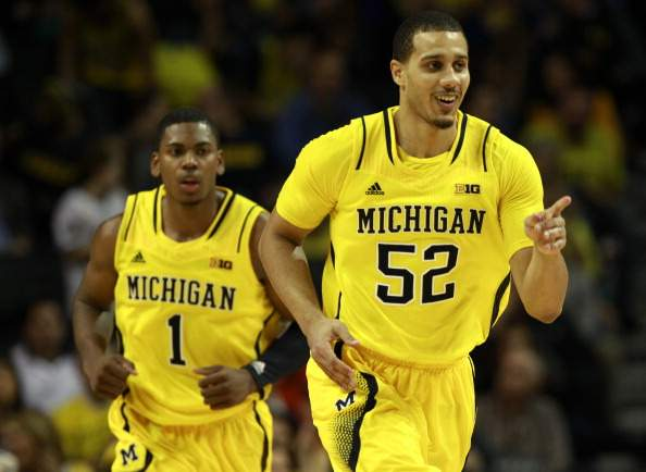 Jordan Morgan must keep Elliott Eliason off the glass Saturday when Michigan plays Minnesota. (Adam Hunger, Getty Images).