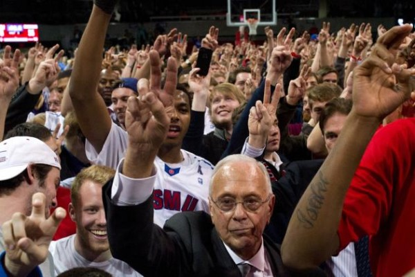 Cooper Neill/Getty Images Larry Brown and celebrates with SMU fans after his Mustangs beat Cincinnati to shake up the league standings.