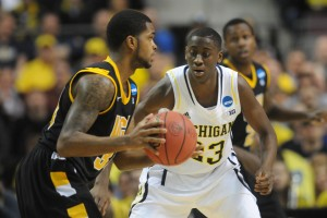 Caris LeVert (right) is arguably the most versatile player in the Big Ten.