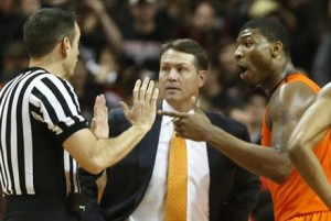 Travis Ford and Marcus Smart share the weight of a basketball program on their shoulders. (Tori Eichberger/AP Photo)