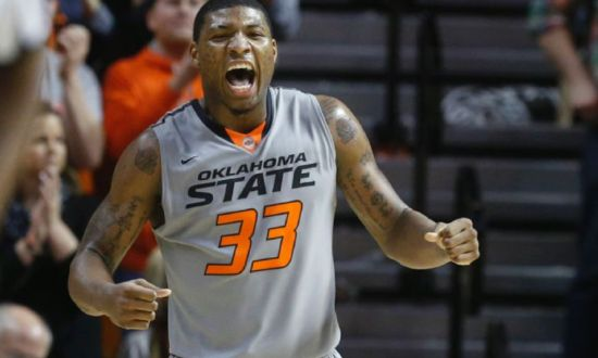 A big second half was the difference for Marcus Smart and the Cowboys. (AP)