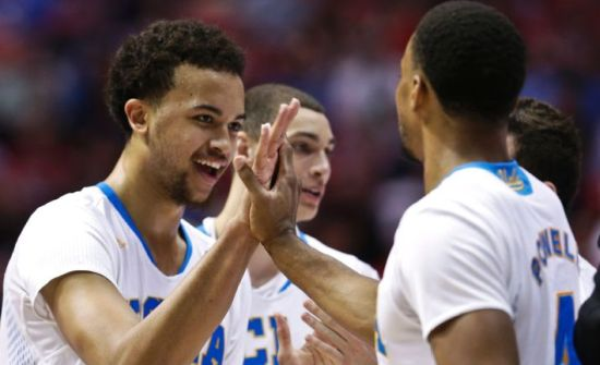 Kyle Anderson (left), Zach LaVine, and Norman Powell had a lot to celebrate about as the Bruins easily advanced to the Sweet 16. (AP)