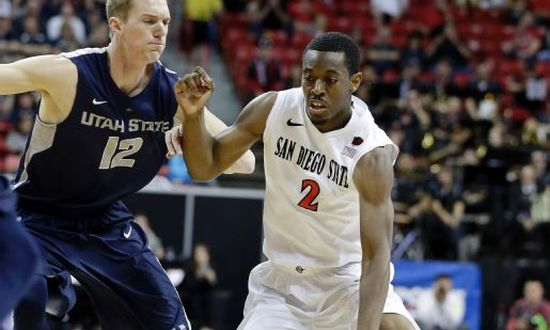 X(avier) has marked the spot all season long for the Aztecs. On Thursday, the Mountain West Player of the Year contributed 15 points and seven assists in a rout of Utah State. (AP)