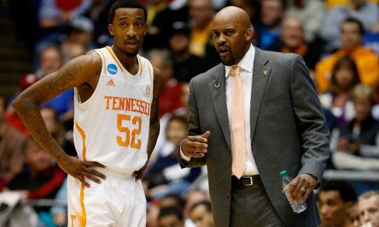 Tennessee head coach Cuonzo Martin speaks with #52 of the Tennessee Volunteers during the first round of the 2014 NCAA Men's Basketball Tournament against the Iowa Hawkeyes at UD Arena on March 19, 2014 in Dayton, Ohio. (Photo by Gregory Shamus/Getty Images)