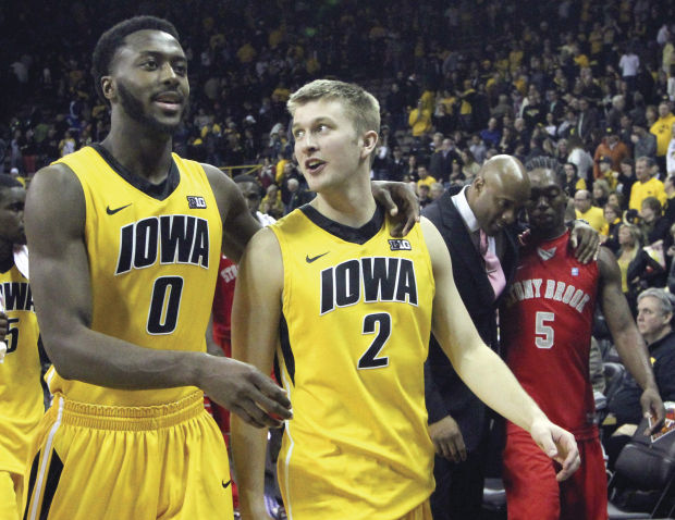 Gabriel Olaseni and Josh Ogelsby need big games for Iowa to advance in the Big Ten Tournament. (John Schultz/Quad City Times)