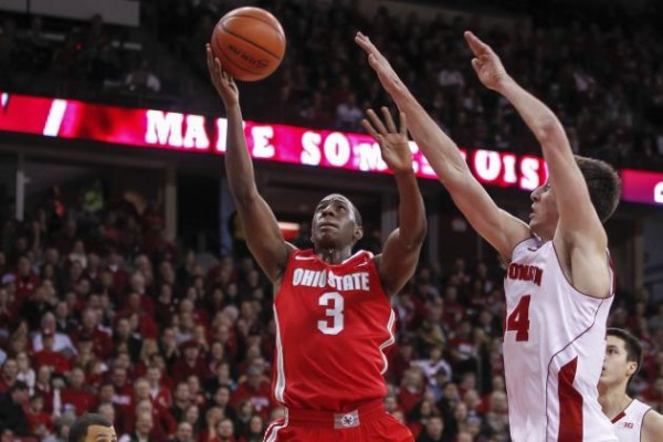 Shannon Scott is leading the Big Ten in assists, but will be tested by Louisville's pressure. (AP)