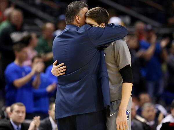 A Shared Moment Between Father and Son (SI.com)