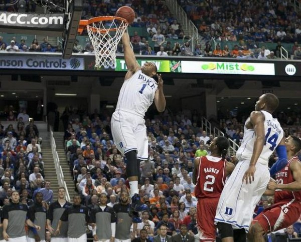 Jabari Parker Slams Home Two of His 20 Points in Duke's Win over N.C. State. (Photo: Robert willett/newsobserver.com).