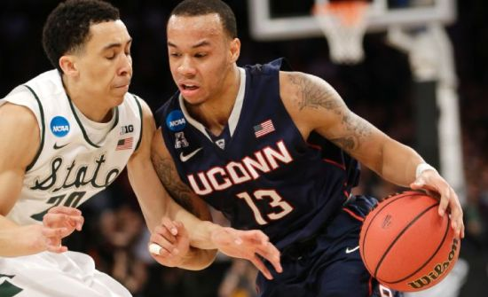 Regardless of how they got here, Shabazz Napier and UConn are now as dangerous as ever. (AP Photo/Seth Wenig)