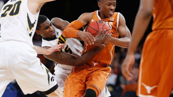 Isaiah Taylor was injured late in Texas's win over Iowa on Tuesday (Associated Press)