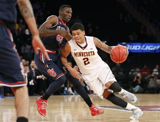 Nate Mason (right) has been a key cog for Minnesota in the early season so far. (Kathy Willens, AP)