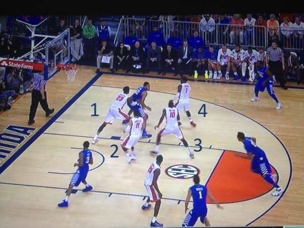 Four players collapse down on Towns with only Booker's defender staying close to home (screen grab via ESPN).