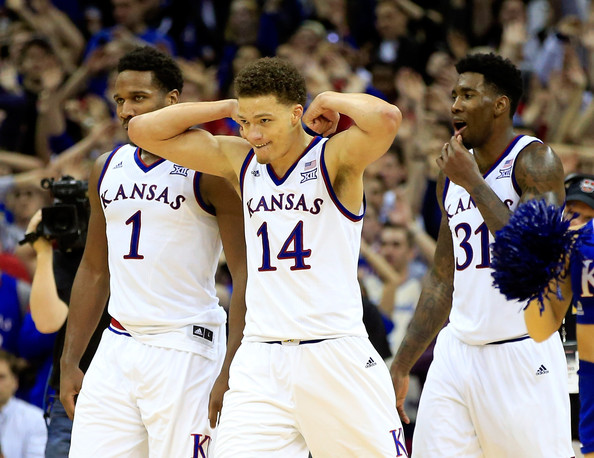 Wayne Selden (left) and Brannen Greene (center) have made a living torching Big 12 opponents from deep. (Jamie Squire/Getty)