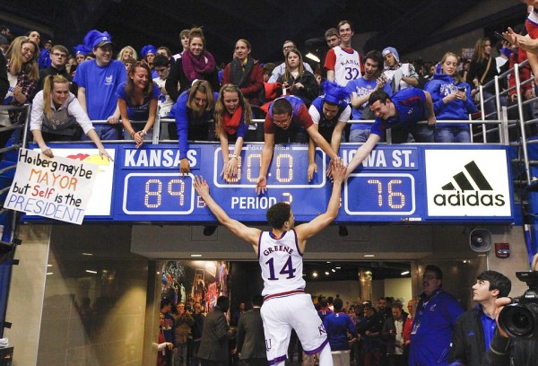 Brannen Greene celebrates with fans after the Jayhawks' win over Iowa State. (Nick Krug/KU Sports)