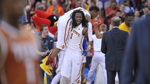 Monte Morris certainly deserved to be carried off the floor after sinking Texas (USA Today Sports).