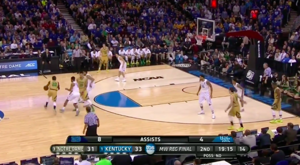 Kentucky doesn't switch on this pick and roll and Grant gives it up.