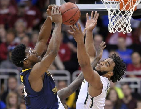 Rico Gathers had 15 points, nine rebounds and two powerful second-half dunks in Baylor's win over West Virginia (West Virginia Metro News).
