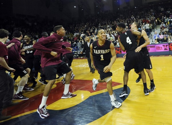 Will Harvard pull off another NCAA Tournament upset? (Michael Perez/AP)